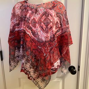 Red and white tank with flowing overlay
